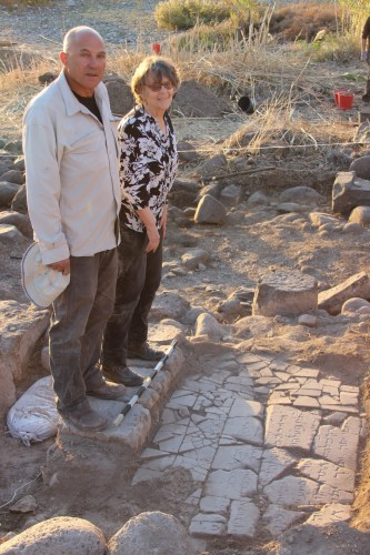 Haifa University Archeologits at the Discovery Site Dr. Haim Cohen (Left) and Professor Michal Artzy (Right) standing next to their discovery. Courtesy of the University of Haifa