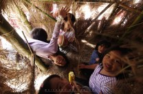 10: Local town children of Sagada in Mountain Province cheerfully poses for photo inside their make-shift play house made out of bamboo and grass.