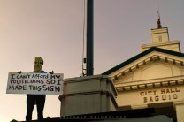 12: A protester wearing paper mask protests in front of the Baguio City Hall concerning the cutting/earth balling of more than hundreds of trees around a shopping mall in Luneta Hill.