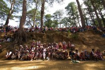9: Generations in Contrast. Local town folks of Sagada in Mountain Province are seen just above of participating men and women from Benguet province wearing their full traditional garbs as they wait their turn to perform their cultural dances during the Etag Festival.