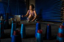 A woman carefully sorts out different shades of blue threads as she makes a pattern in a thread holder to be prepared for looming a traditional Ilocano weaving at the Heritage City of Vigan in Ilocos Sur, Philippines.