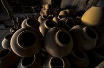 Stacks of unsold hard clay pots of Fidel Go is seen inside his work place in Vigan City in Ilocos Sur.