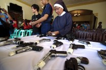 """assorted surrendered licensed firearms were laid on a long table ready for muzzling and labeling after the Unity Walk Vigan political candidates held by Sister Lilian E. Carranza of OSB (Order of St. Benedict), chairperson of PPCRV-NAMFREL along Nueva Segovia Street going to the Vigan City Hall. These firearms were surrendered by local citizens after the Vigan CPS's """"Oplan Katok"""" operation, non of them belonged to any of the political candidates as Vigan Mayor Eva Singson Medina told to the media """"We are a gun-less society""""."""
