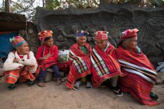 """Elders from Sadanga, Mountain Province, bear the coldest weather yet in the summer capital as they gather around Baguio Botanical Garden tightly wrapped in their colorful, woven """"tapis."""" The temperature dropped to 9.5 degrees Celsius in Baguio City."""
