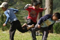 "Local children of Sagada in Mountain Province, north of Philippines, are seen playing ""pak-paka-ak"", a simple child's play where they tangle and lock one of each other's feet and humps around in circles and do their best to balance themselves without falling down."