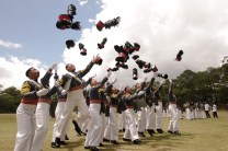 Graduating cadets of the Philippine Military Academy rejoice by hurling their caps in the air after completing four years of studies.