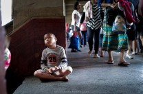 At a very young age, this little boy sits on a corner of an overpass in Baguio City begging for alms from the public.
