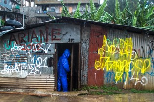 A local volunteer checks out the emergency flood control equipments and tools shack at the flood prone community of City Camp in Baguio City as a storm had just arrived.