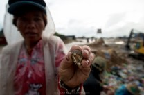 GARBAGE OF ONE, TREASURE OF ONE. A woman shows-off one of her jewelry collections that she found at a dump site in Irisan, Baguio City.