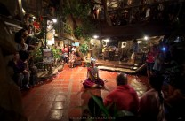 A performing artist from India performs in front of a crowd inside the Oh My Gulay restaurant in Baguio City.