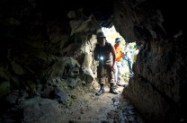 A SECURITY employee of the government's John Hay Management Corp. inspects a tunnel operated by an illegal small-scale mining group at Barangay Camp 6, within the forest reservation of Camp John Hay in Benguet.