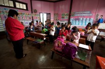 A teacher leads an opening morning prayer to elementary pupils on Lepanto Elementary School in Mankayan, Benguet.