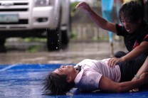 Women from mixed martial arts club from Baguio City wrestles in a demo fight during a festival in Bontoc in Mountain Province.