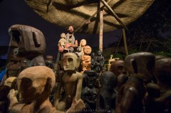 """Artist Kawayan de Guia and the 82 """"bul-ul"""" bound for a Singapore exhibition arranges some of it before starting a traditional Ifugao ritual to ask for safe travel."""