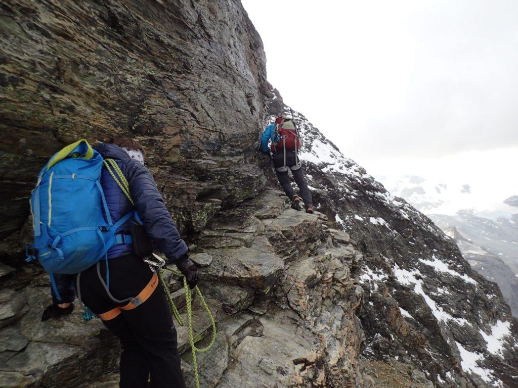 Climbing over slippery rocks