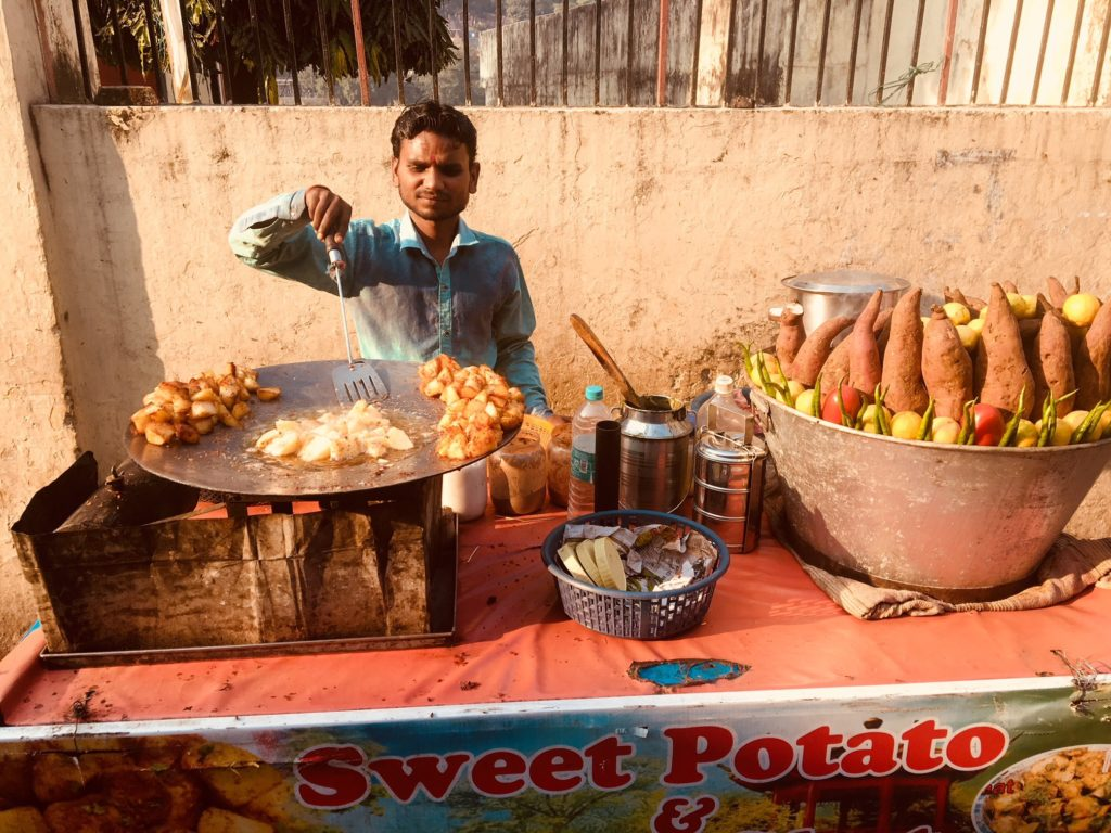 Street food vendor in Indian serving up potatoes