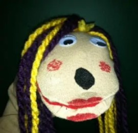 Joy The Sock Puppet is the official Spokes-Puppet for The Joy Of Sox - providing socks for the homeless.