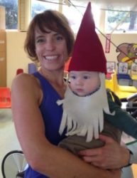 Dee holding garden gnome baby