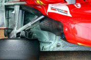 See how exhaust is blown onto the floor, and the fence keeps air away from the tyres