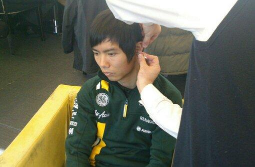 ...Nope he's not lost sonething in his ear - being fitted for earplugs #F1Detail