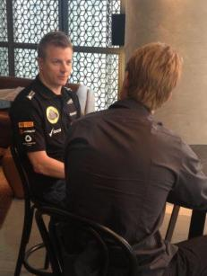 ...meanwhile Kimi's doing an interview - is that grey hair???