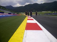 """""""Yellow kerb outside T1, so not possible to go as wide as back in 2003"""""""