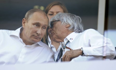 Mandatory Credit: Photo by Staley/LAT/REX (4191720b) Bernie Ecclestone talks with Russian President Vladimir Putin during the race. Russian Formula One 1 Grand Prix, Sochi, Russia - 12 Oct 2014.