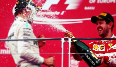 Sebastian spays champagne on the podium