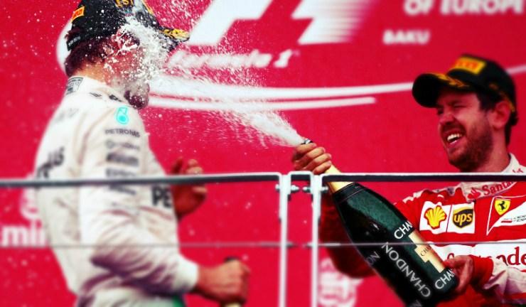 Sebastian spays champagne on the podium