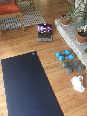 yoga mat and dumbbells - exercising to cope with COVID