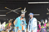 Two of the main dancers pose for a picture in the middle of one of the dances