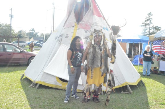 My mother poses with a cheif in front of the big teepee.