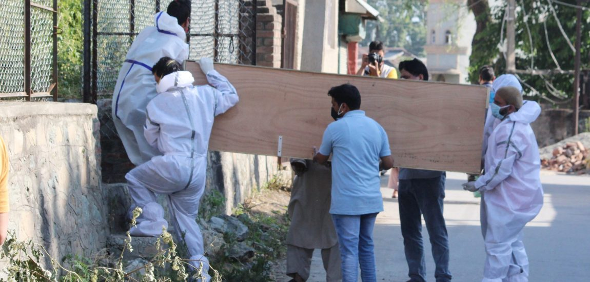 Body of a Covid-19 victim being carried, for last rites, under strict protocol in Srinagar…