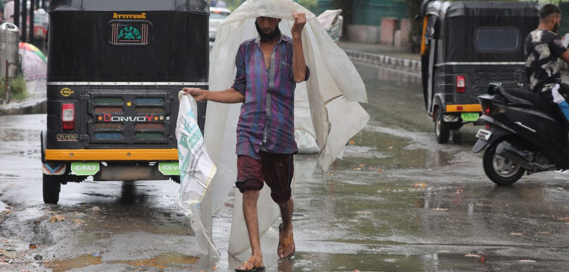 Covering himself under a water-proof polythene sheet…