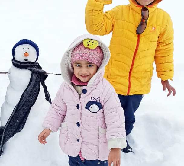 Snow brings joy to the faces of young children who are enjoying…