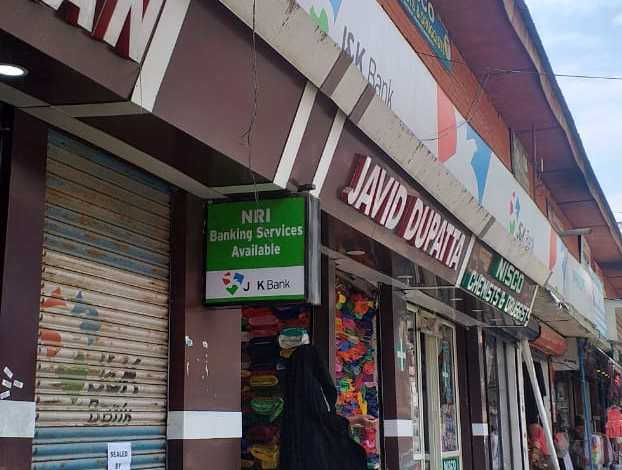 JK bank building sealed in new market Anantnag by WAKF board for not paying rent