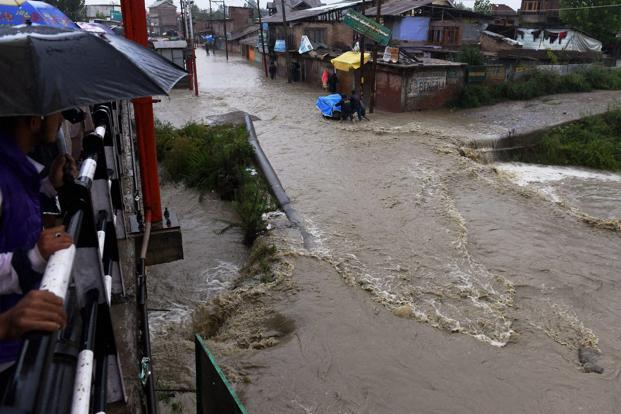 Flash Floods hit Lolab: Woman killed, houses, crops damaged, foot bridge washed away