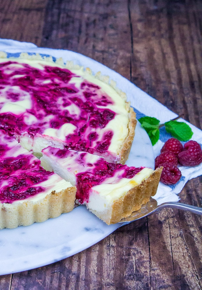 Super pretty Keto dessert and kinda easy to make. We love this Low Carb Raspberry Cheesecake Tart.