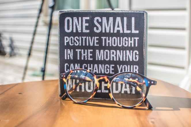 photo of a sign and eyeglasses on table hopes and goals.