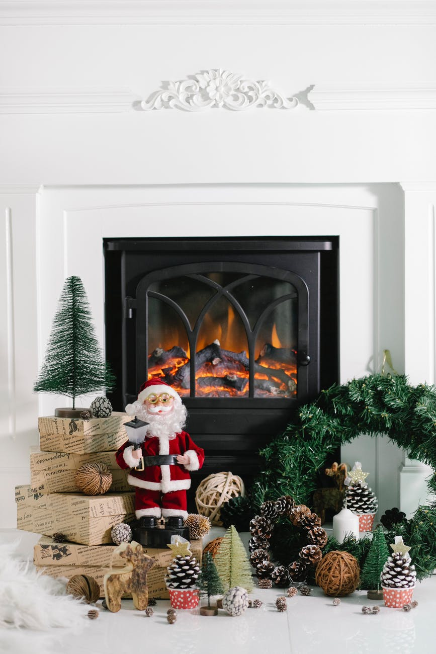 burning fireplace with christmas decoration in cozy house