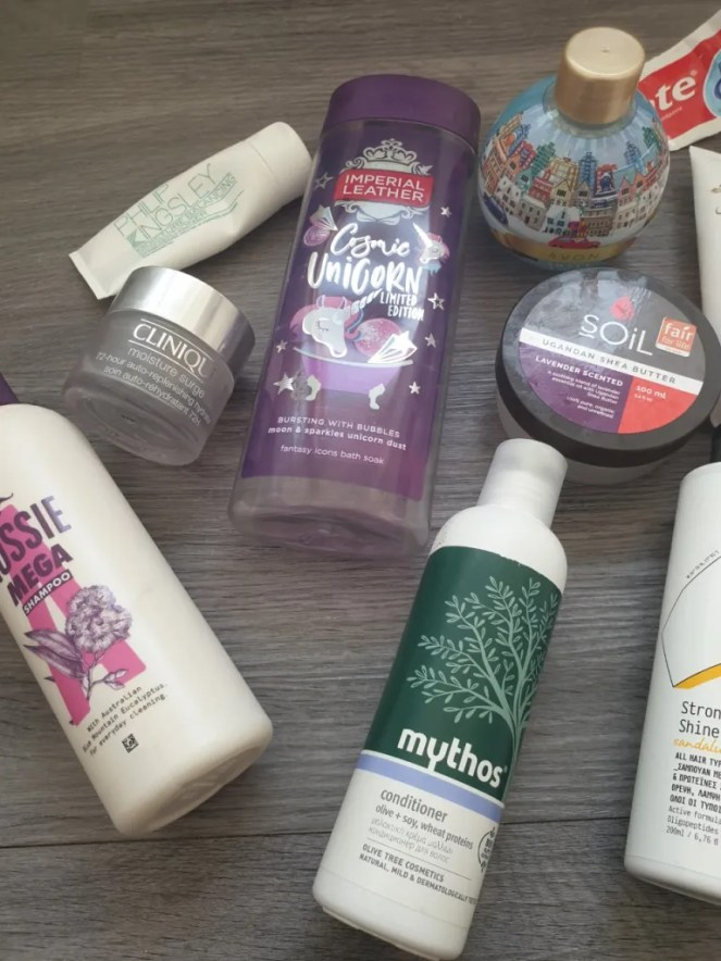 Upclose flatlay of some of the product empties mentioned within the post.