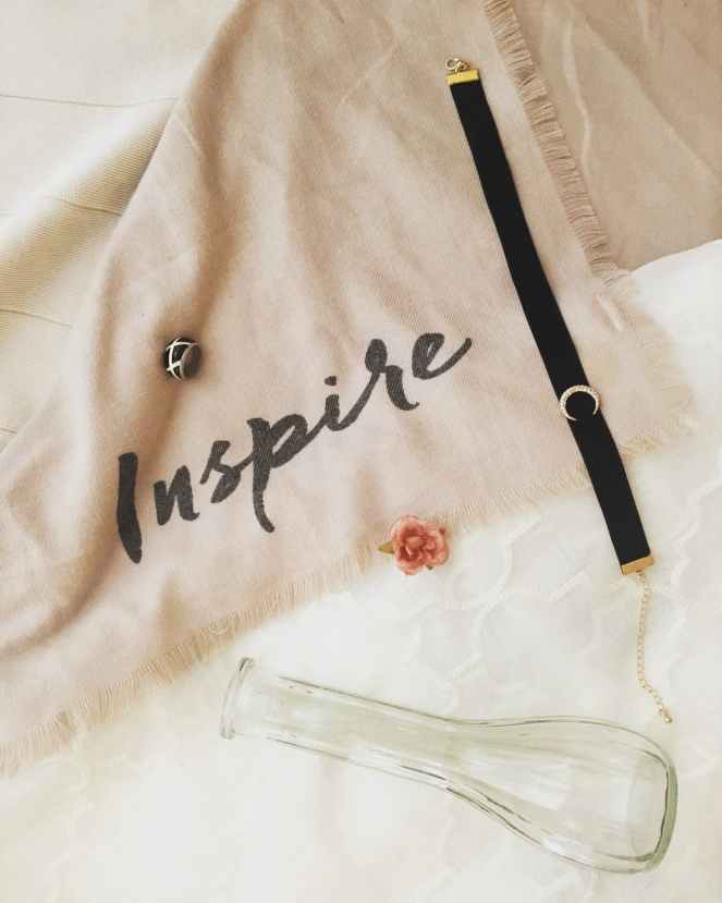 black choker on beige scarf with the word inspire written for tips for achieving your goals post.