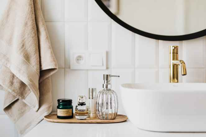 set of skin care products in contemporary bathroom for product empties post
