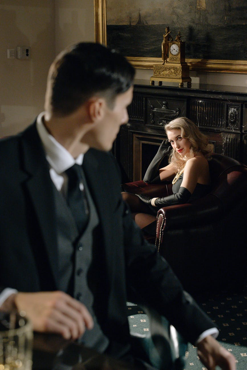 photo of man looking at sophisticated woman