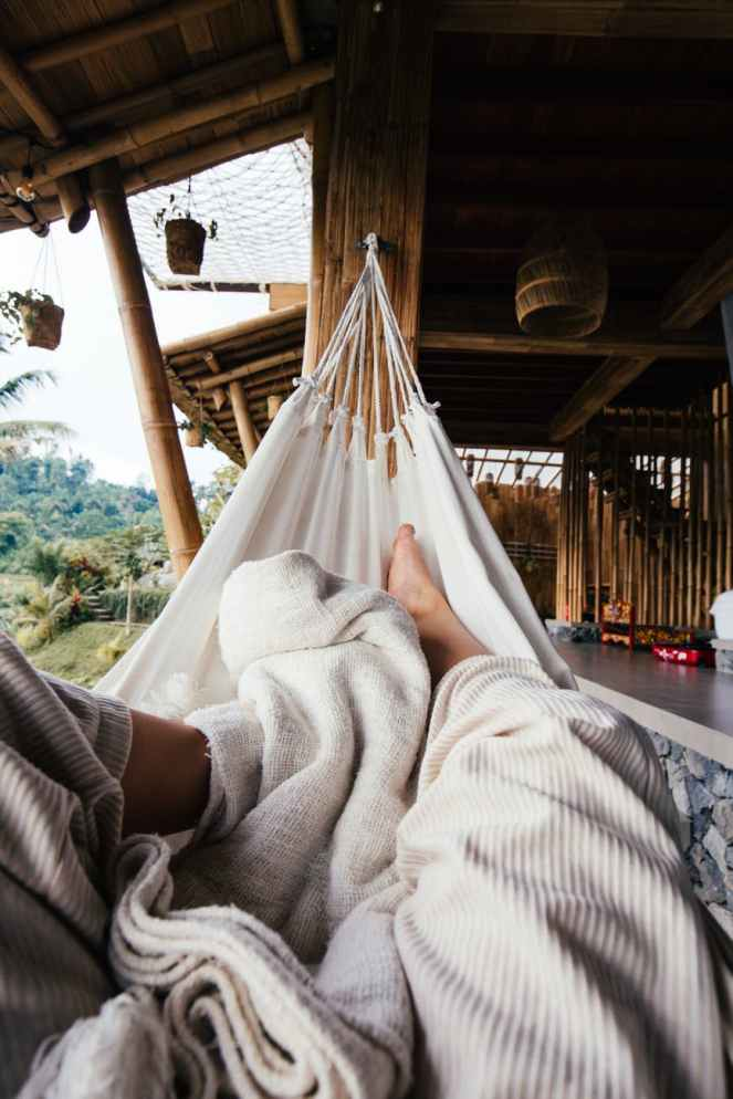 faceless person resting on hammock for 5 things to do to make your weekend stress-free post.