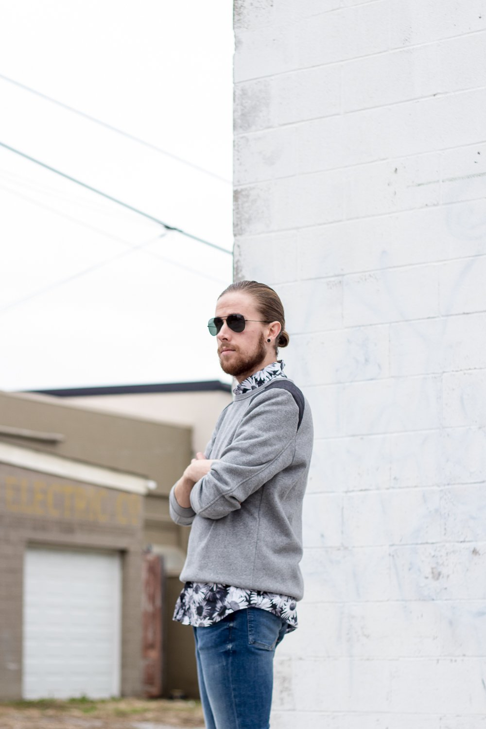 The Kentucky Gent, a Louisville, Kentucky men's life and style blogger, in Topman Floral Shirt, H&M Sweatshirt, H&M Skinny Jeans, Steve Madden Troopah Boots, and Ray-Ban Aviator Sunglasses.