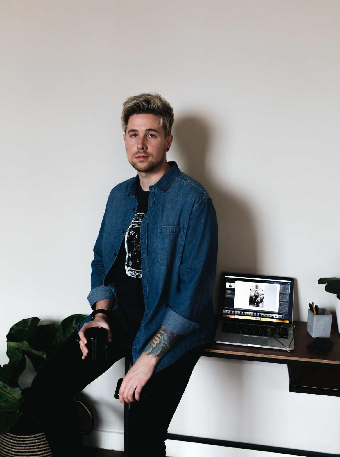 man sitting on desk