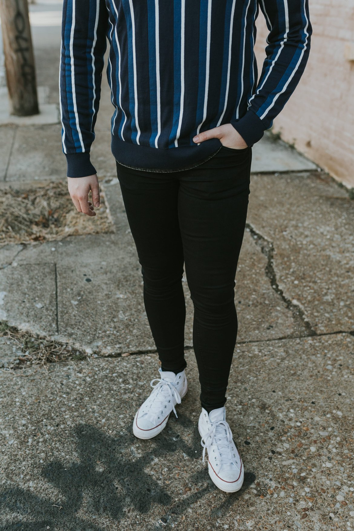 blue striped sweater with black jeans