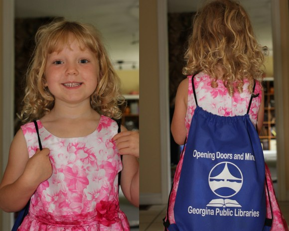 Miranda's rocking her library swag! The kids want to wear these bags everywhere now - LOL!