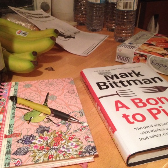 Cottage kitchen table. Sums up things well - book, puzzle, bananas, pump manual, water bottles, notebook and pen.
